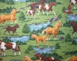 Multi Color Horses in Gras with Water and Trees